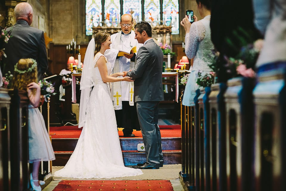Bride and groom exchange rings in church