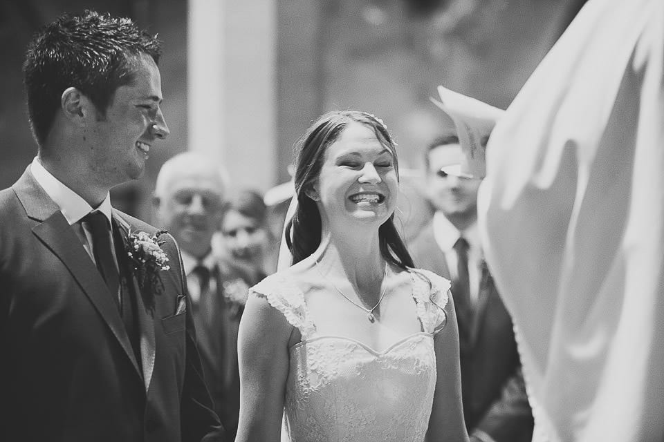 Bride and groom looking excited during the ceremony
