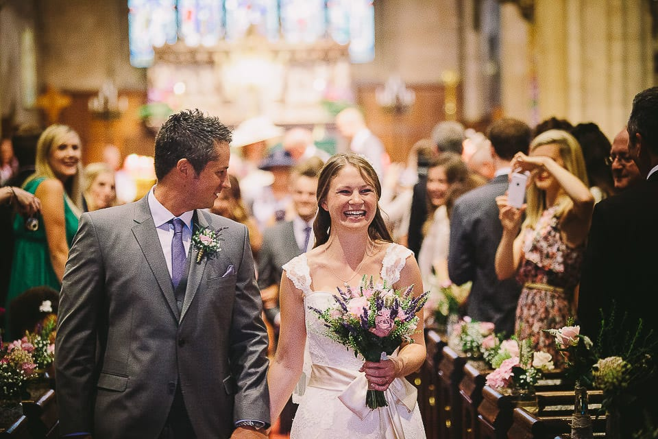 Bride and groom walking down the aisle in Christ Church