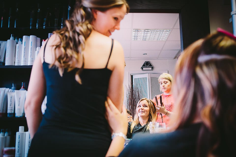 Bride showing off the back of her hair at the hairdressers