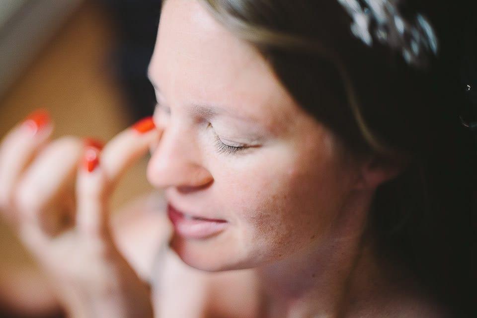 Bride having her make up done