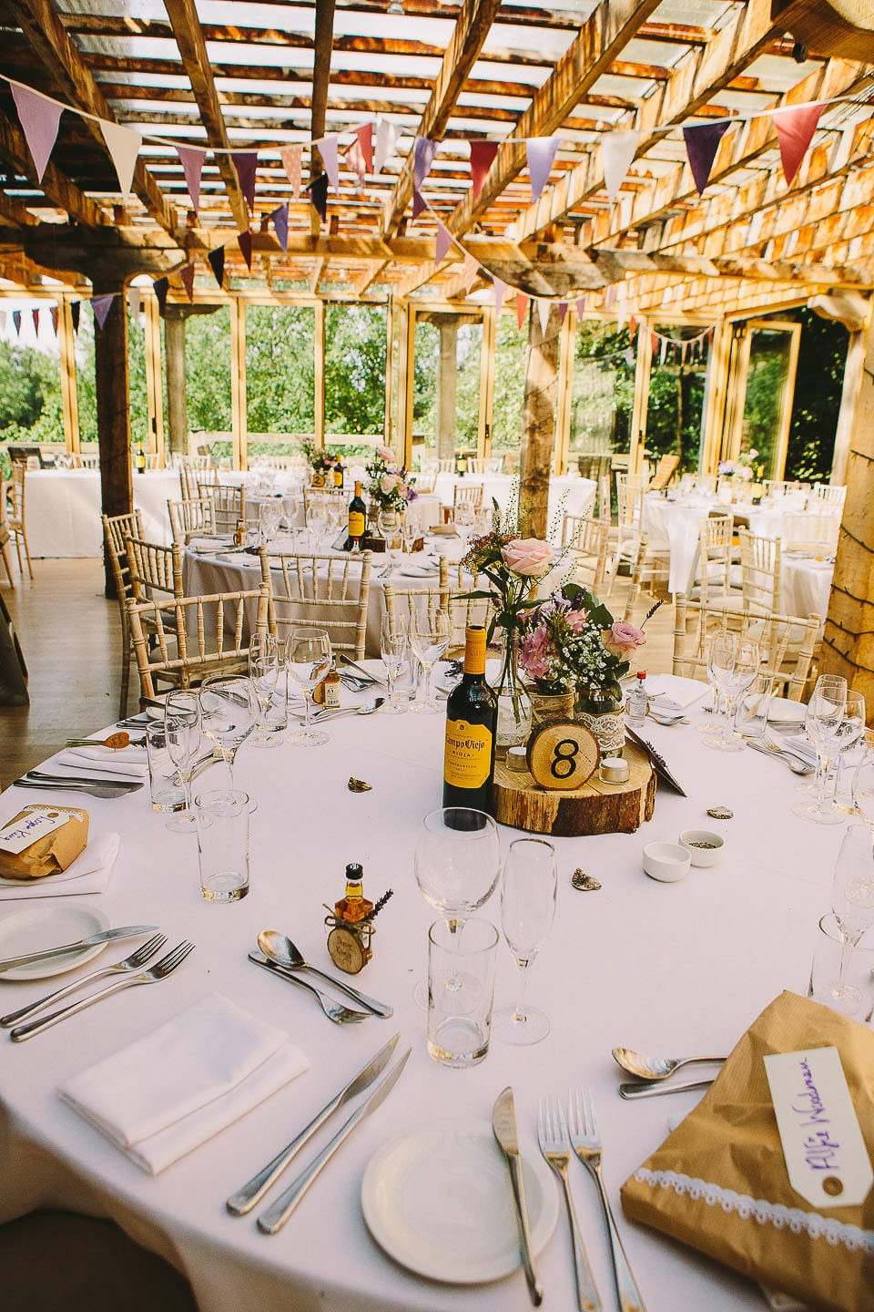 View of the tables and room set for wedding breakfast at Abbey House Gardens