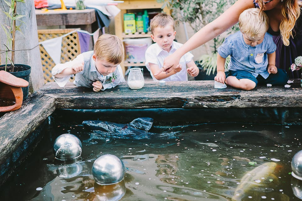 Children looking at the fish in the pond at Abbey House Gardens