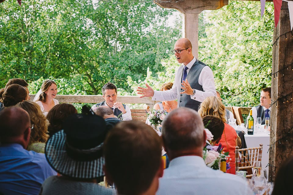 Groomsman announces the grooms speech at Abbey House Gardens