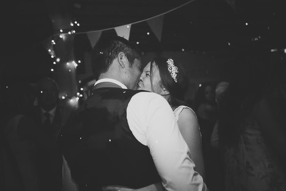 Bride and groom share a kiss on the dance floor at Abbey House Gardens