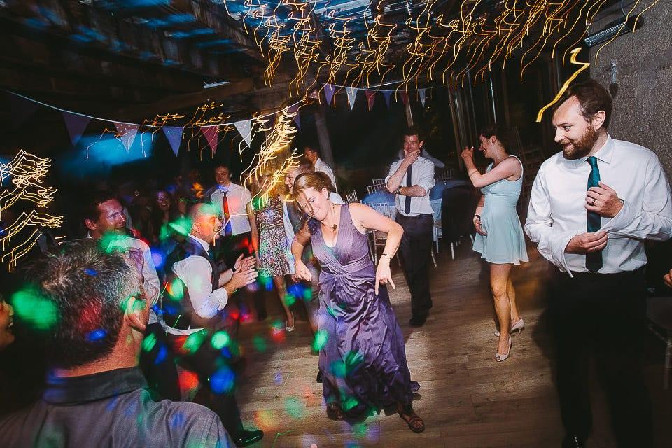 Bridesmaid having a wild dance at Abbey House Gardens