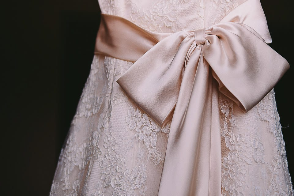 Close up of the brides wedding dressing hanging up