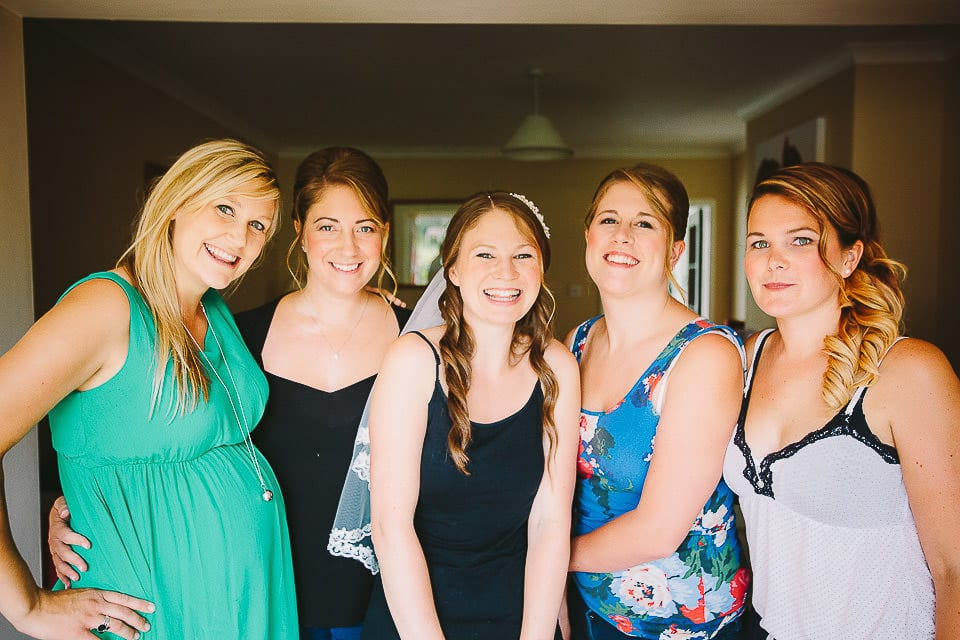 Bride and bridesmaids at home before getting into dresses