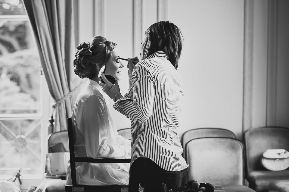 Black and white image of bride having her make up finished at Bath Spa Hotel