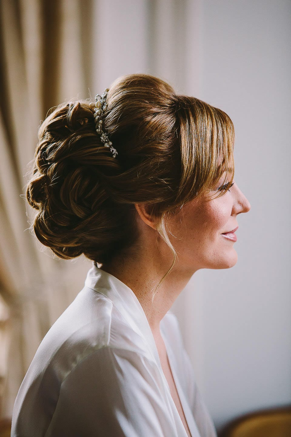 Profile portrait of the bride after having her hair and make up finished