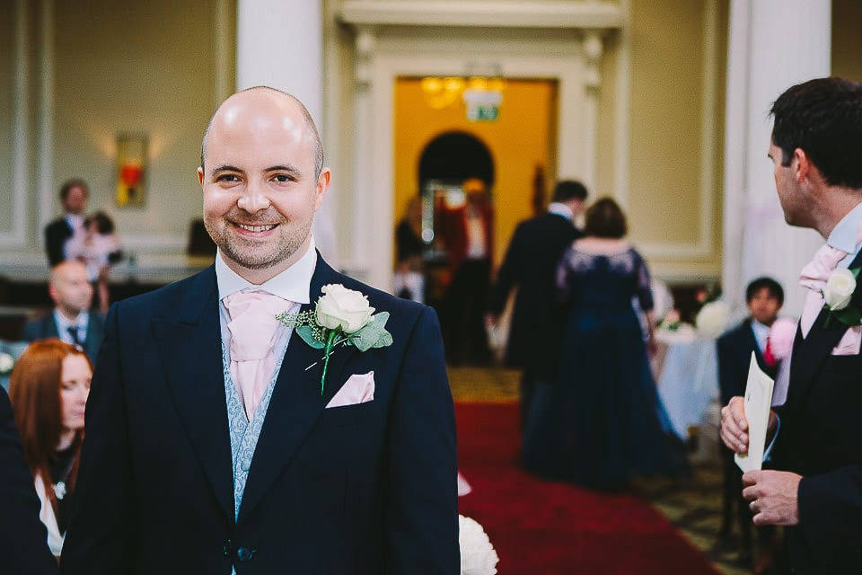 Groom waiting for his bride in the ceremony room at Bath Spa Hotel