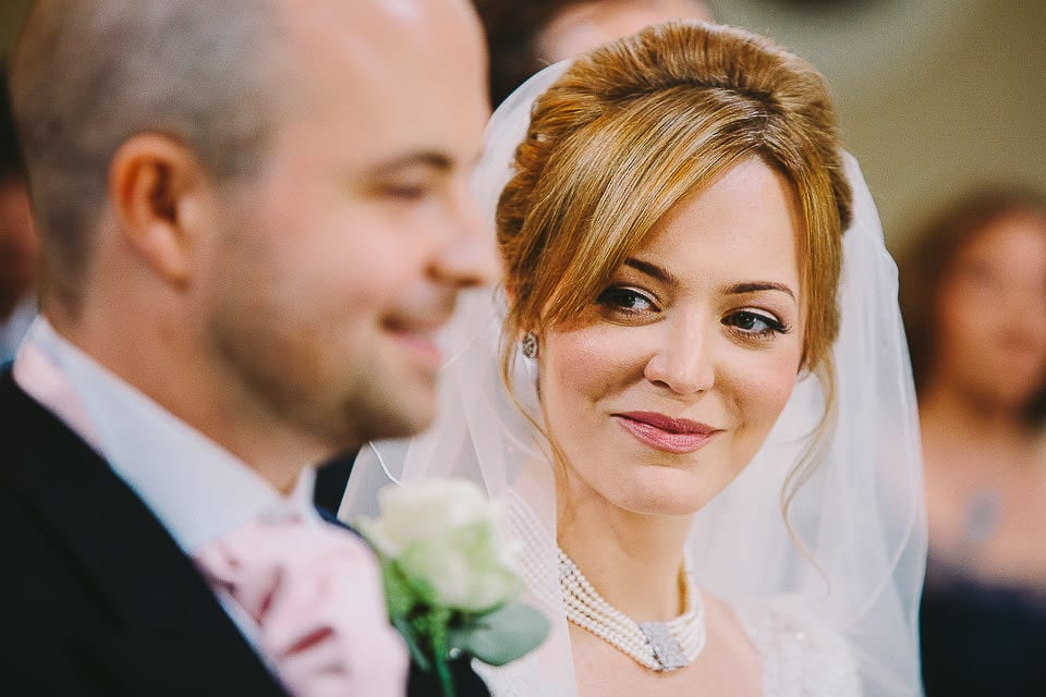 Bride looking at her groom during the ceremony at Bath Spa Hotel