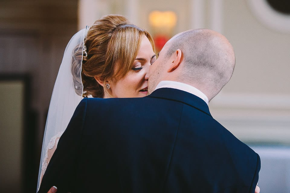 Bride and groom having their first kiss at Bath Spa Hotel