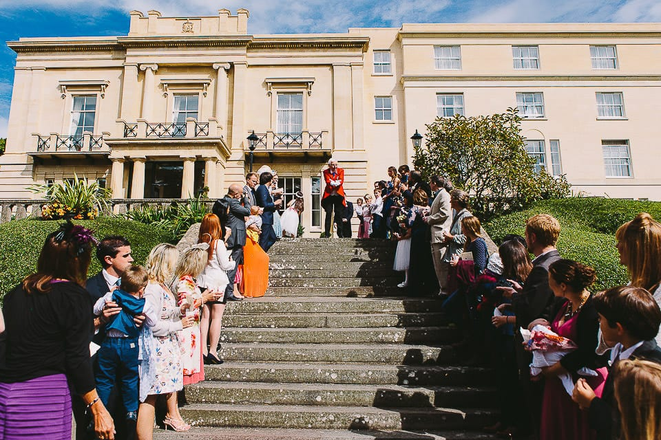 Guests lining the steps ready to throw confetti at Bath Spa Hotel