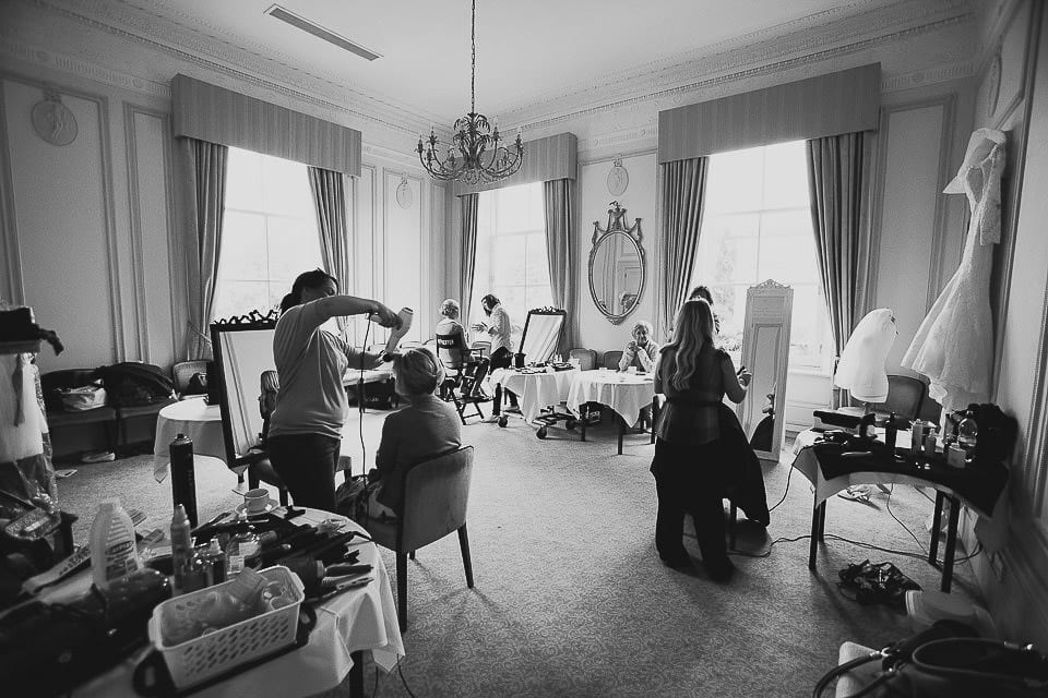 Black and white wide shot of the hotel room with girls getting ready at Bath Spa Hotel