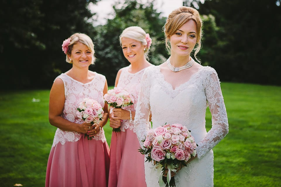 Portrait of bride and bridesmaids in the gardens at Bath Spa Hotel