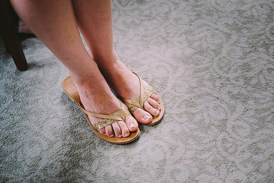 Brides feet in flip flops during bridal preparation