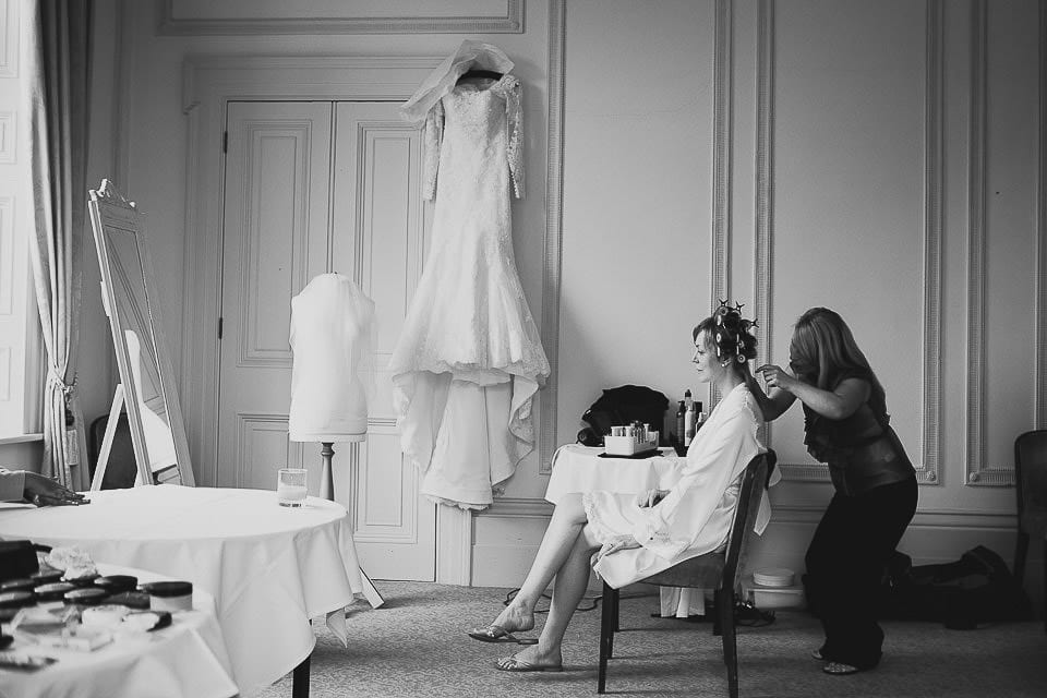 Bride having her hair done in the hotel room at Bath Spa Hotel