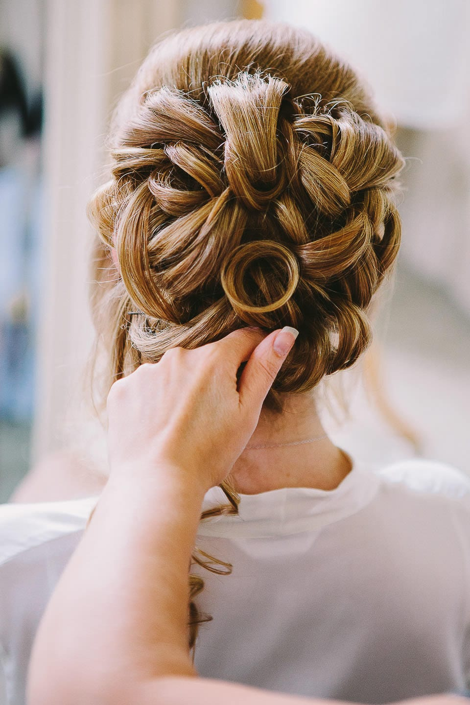 Back view of the brides hair being finished at Bath Spa Hotel