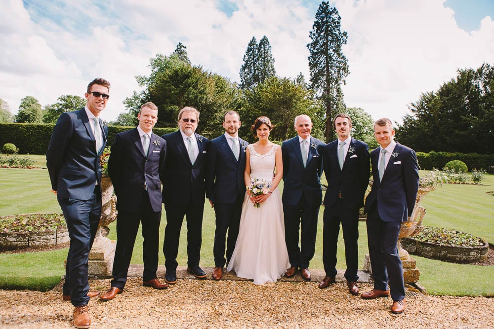 Bride and groom and their groomsmen in the gardens at Grittleton House