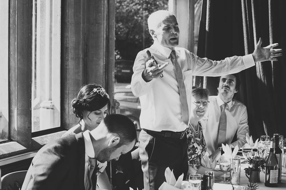 Black and white image of father of the bride doing his speech at Grittleton House