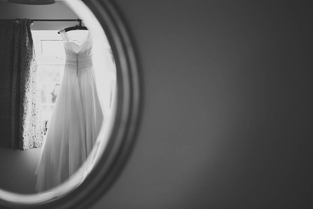 Black and white image of the dress in the mirror