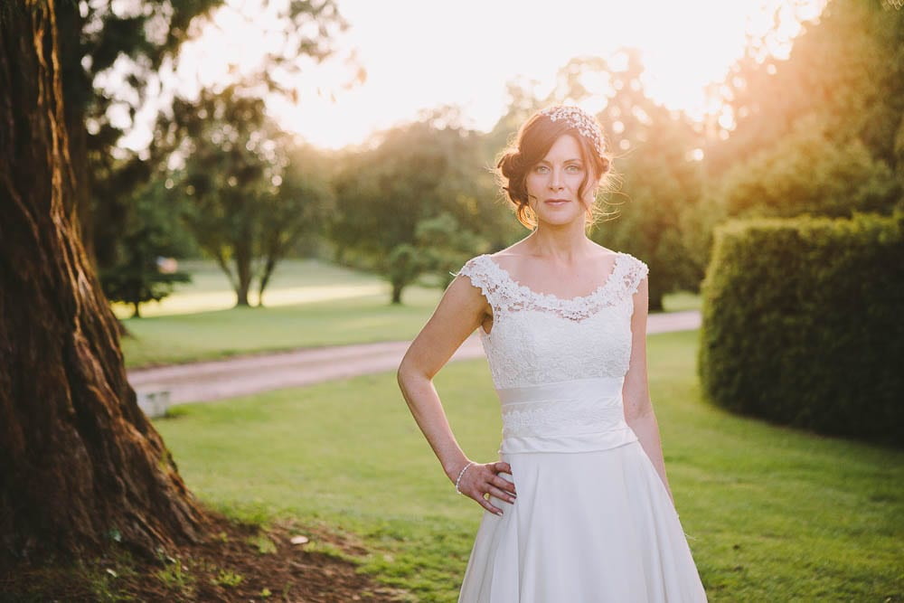 Sunset portrait of the bride in the gardens of Grittleton House
