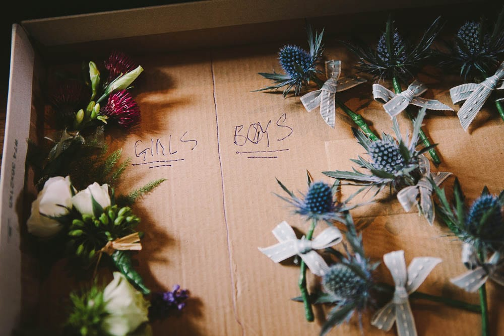 Close up of the buttonholes waiting in Great Somerford church