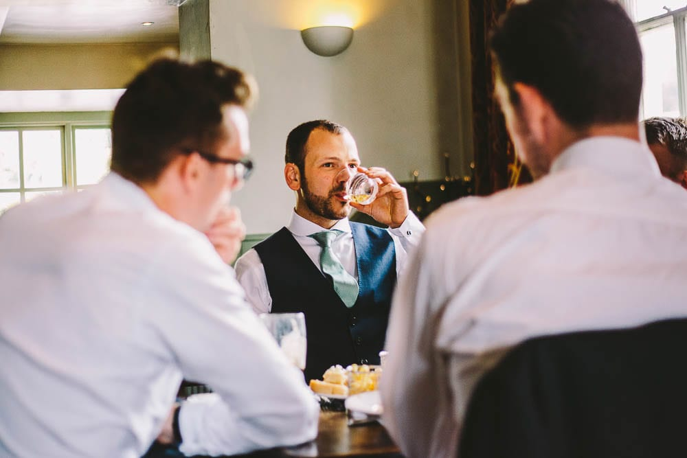 Groom downs his whiskey in the Somerford Arms