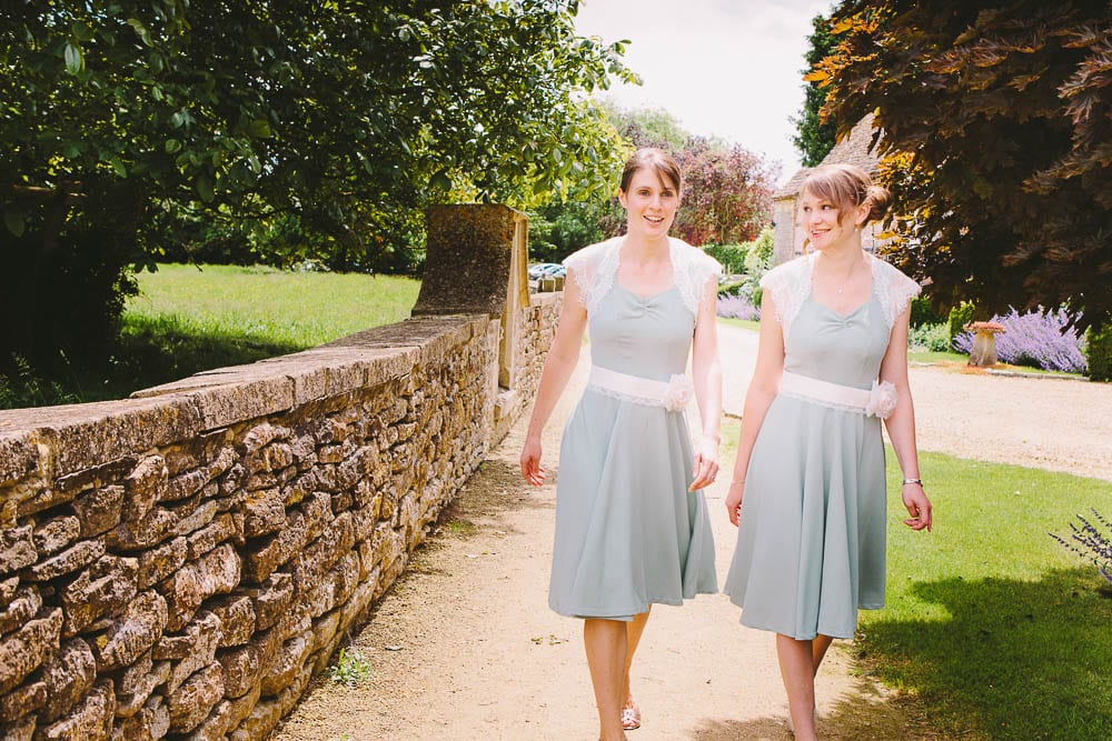 Bridesmaids walking up the path to Great Somerford Church