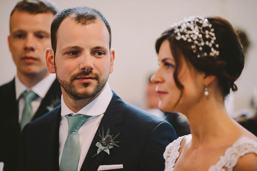 Close up of the bride and groom during the ceremony at Great Somerford church