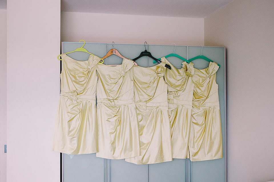 Bridesmaids dresses all hanging on the wardrobe at The Captains Club Hotel