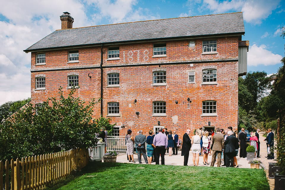 View of the mill and guests outside at Sopley Mill