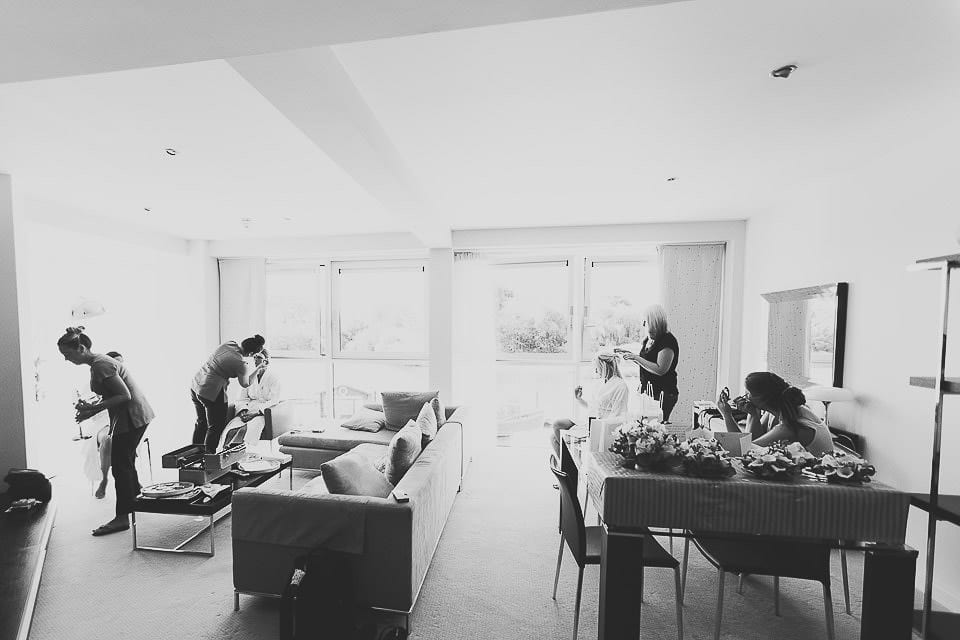 Black and white wide view of hotel suite for bridal preparation at The Captains Club Hotel