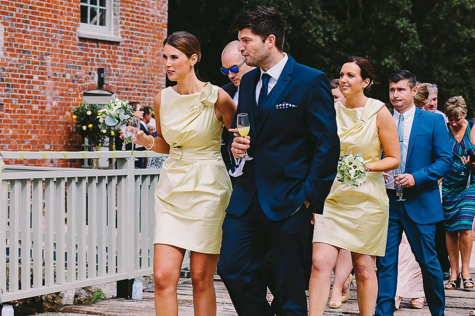 Bridesmaids and their partners walking outside at Sopley Mill