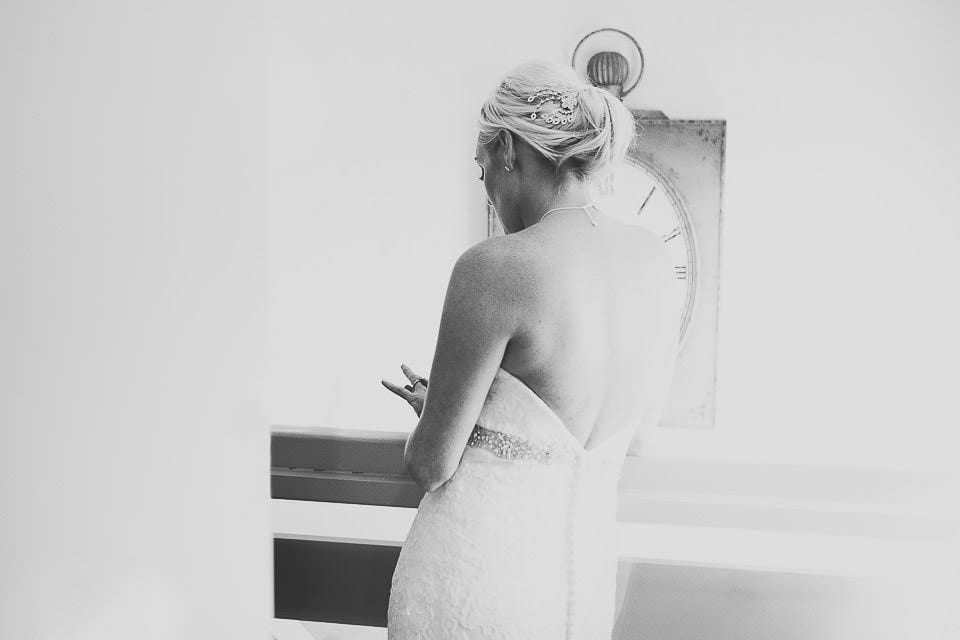 Black and white image of the bride looking at her wedding ring before wedding breakfast