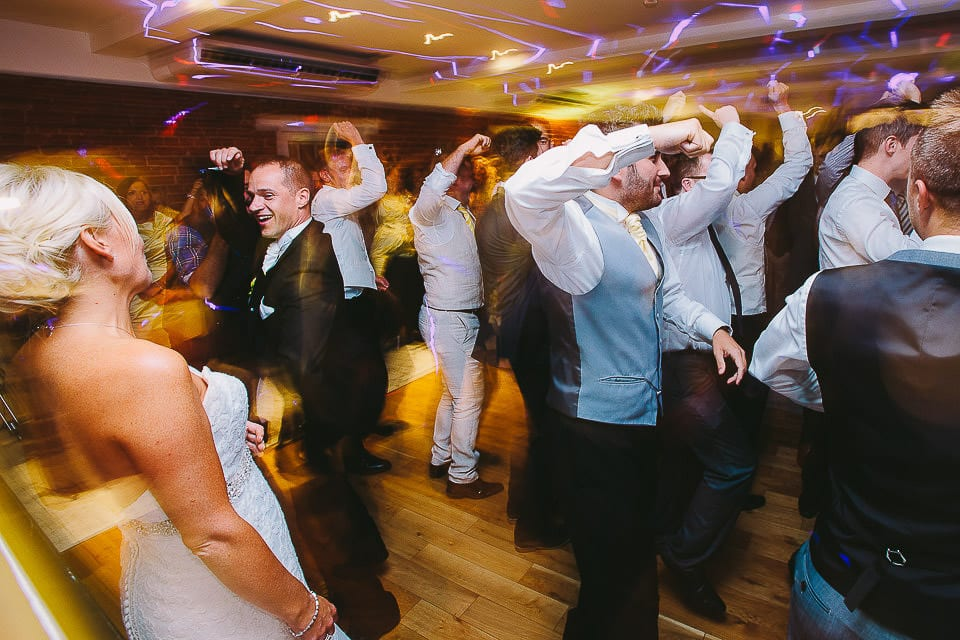 Groom and his friends surprising the bride with a dance at Sopley Mill