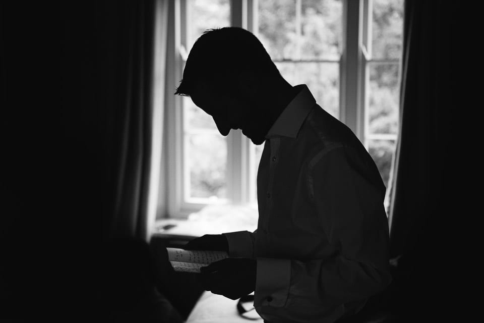 Groom reading a message from his bride