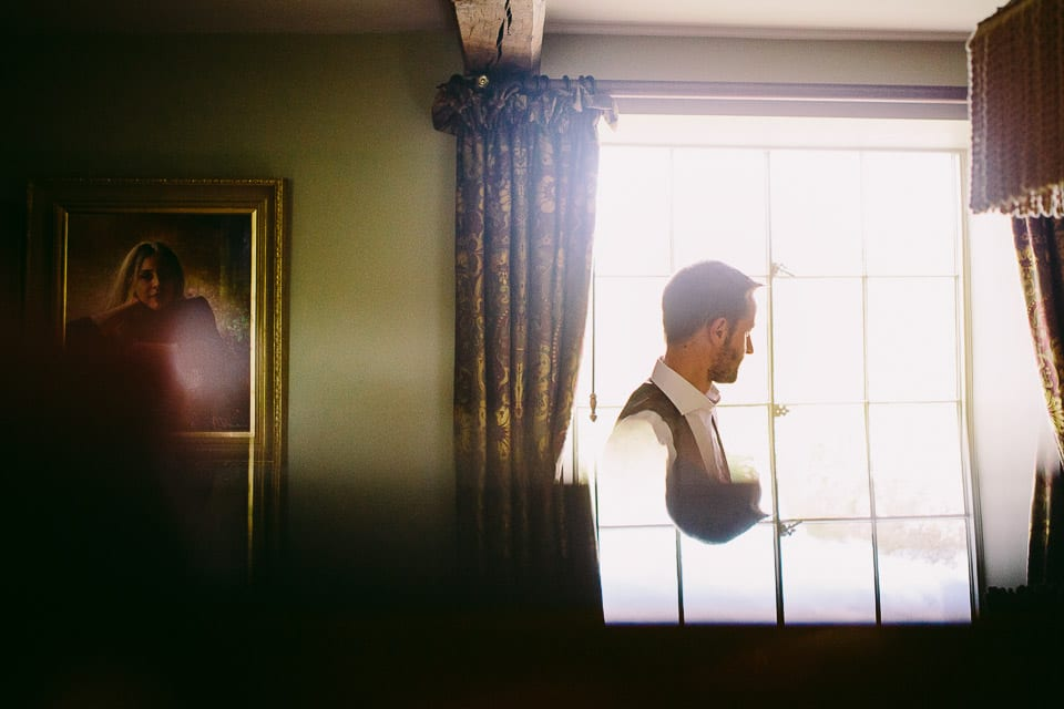 Reflection of groom in front of the window