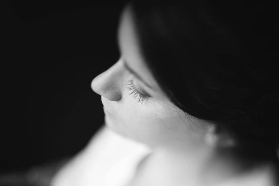 Close up of brides face in black and white