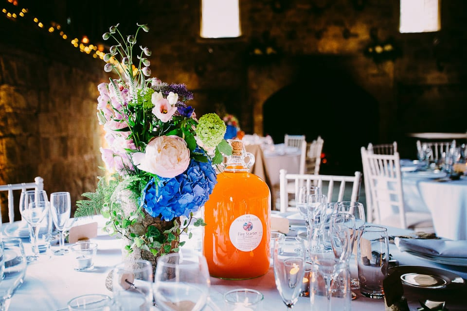 Close up of table decoration with jar of cider