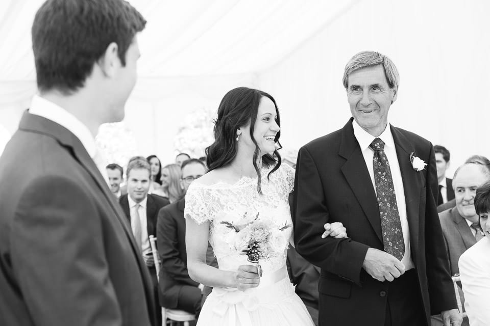 Black and white image of brides entrance with her father