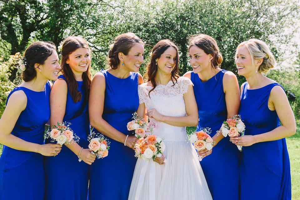 Bride having a laugh with her bridesmaids