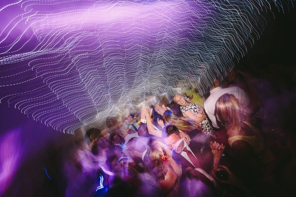 Bride dancing on dancefloor with friends
