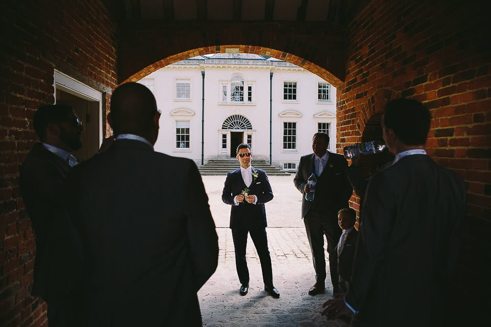 Groom and his groomsmen waiting in courtyard