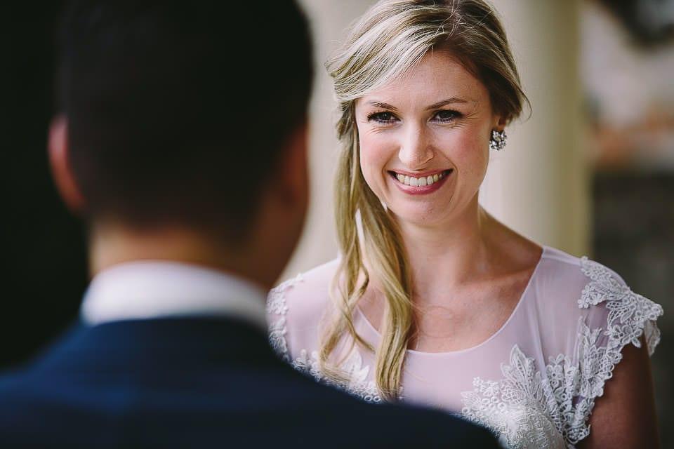 Close up of bride over grooms shoulder