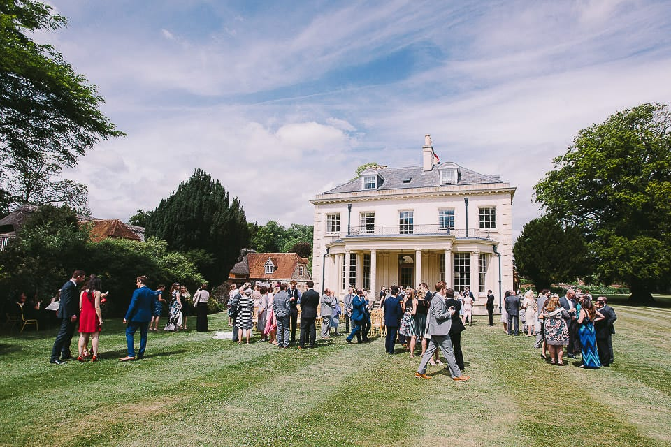 Wide view of Rockley Manor with guests after ceremony