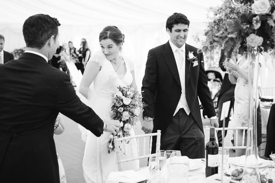 Black and white image of bride and grooms entrance to wedding breakfast
