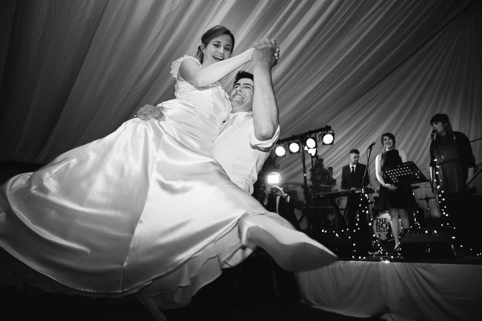 Black and white image of bride and grooms first dance