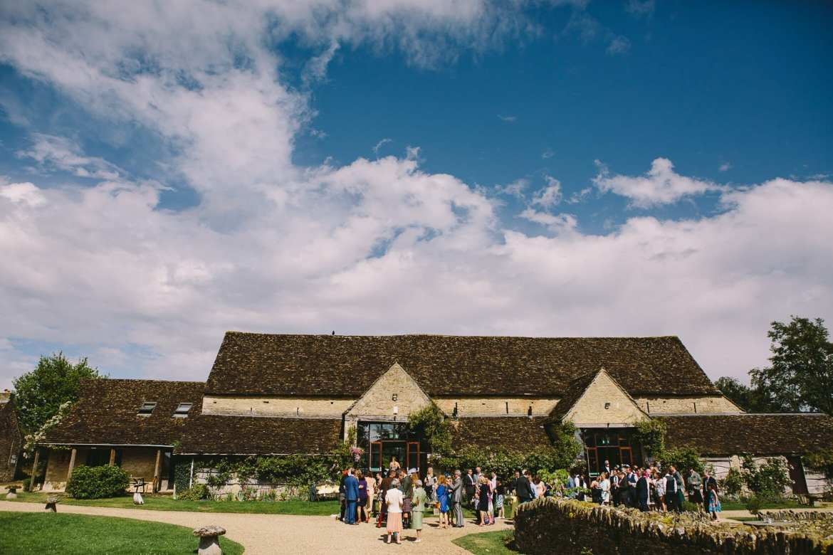 Wide image of Great Tythe Barn with guests